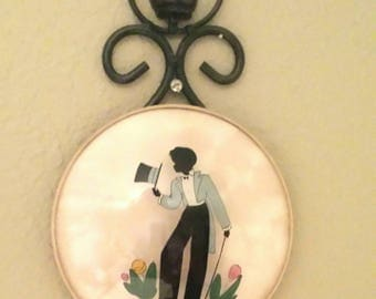 Reverse Painting Silouette Gentlemen in a Tailed Suit, Top Hat, and Faux Butterfly Wing Art Background by Edna Lewis