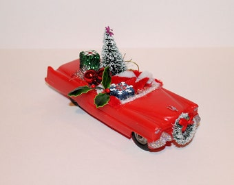 Vintage Red Plastic Cadillac, Upcycled for Christmas with Christmas Tree, Presents, Ornaments and Christmas Lights and Glitter