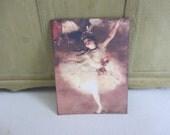 Old ballerina poster on cardstock