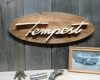 1964 Pontiac Tempest Emblem Oval Wall Plaque-Unique scroll saw automotive art created from wood for your garage, shop or man cave.