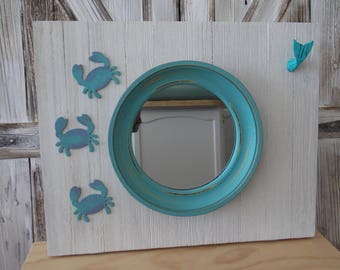 PORTHOLE MIRROR CABINET . Flip Down . Creamy White wi Turquoise . Flip Down extra counter . Removable Shelf . Crabs . Whale Knob .  Unique