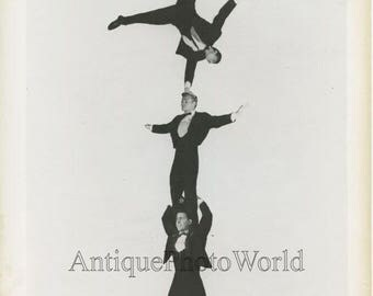 Circus performers balancing act acrobats in human pyramid vintage photo