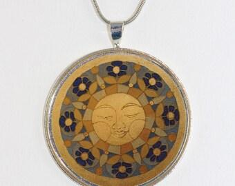 Isla del Sol necklace no. 2-506 golden blue Sun Mandala Islas de la Luz festive artistic designer art jewelry celestial sunlight sunshine