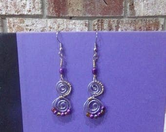 Long Spiral Earring in Purple, Silver, and Gold.