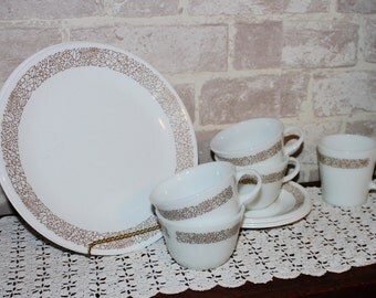 Woodland Brown Corelle dinnerware, odd lot of 11 pieces, dinner plates, cups and saucers, mug, Pyrex, Corelle lot