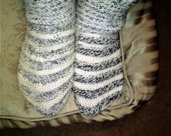 """NEW ITEM! Hand knit """"funky"""" slipper/socks. Grey and white stripes, Color stripes alternate on each sock. Stretchy to fit most sizes,"""