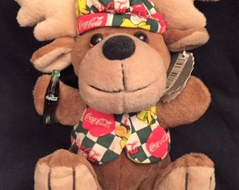 Coca Cola stuffed reindeer holding a Coke bottle