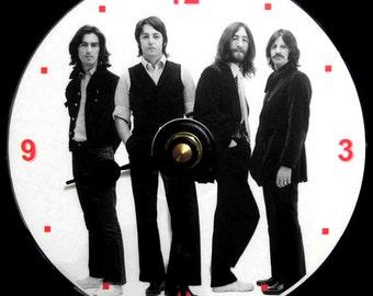 BEATLES Wall CLOCK - CD Size, 4.75 inch diameter. John Lennon, Paul McCartney, George Harrison, Ringo Starr. Makes a nice gift.