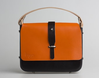 Embassy Bag. Handcrafted Shaped leather messenger