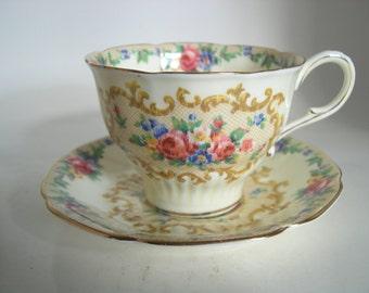 Paragon  Tea cup And Saucer, Yellow Teacup set with flowers, Minuet tea cup and saucer set.