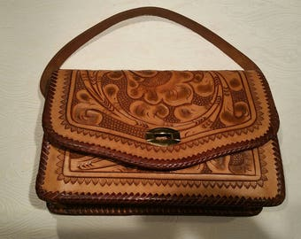 Vintage tooled leather shoulder bag.