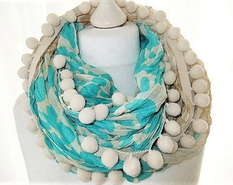 Loop neck Leo pattern turquoise with PomPoms