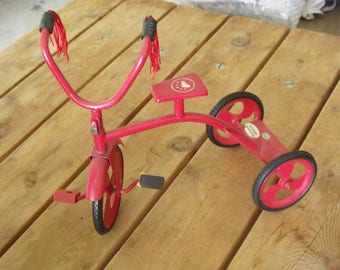 Decorative red  tricycle  metal with rubber tires, and handlebars