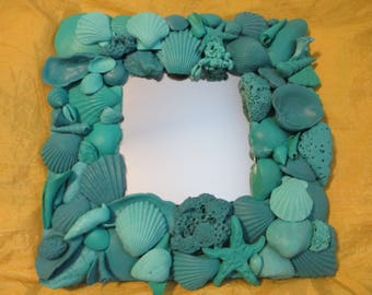 Nautical / beachy painted shades of aqua and turquoise seashell mirror  10 1/4   x  10 1/4
