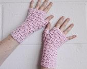 Light pink fingerless gloves, arm warmers, wrist warmers, wristers.