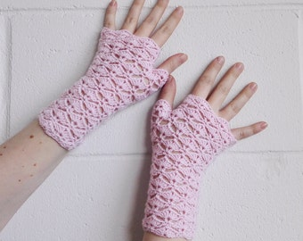 Light pink fingerless gloves, arm warmers, wrist warmers, wristers.
