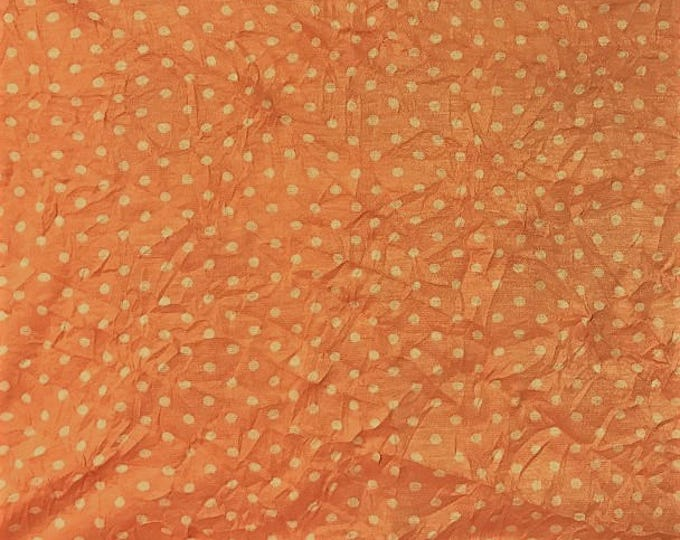 White Polka Dot on Coral Polyester Crinkle Jersey Knit Fabric