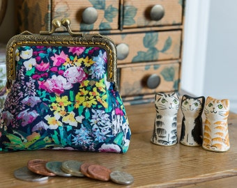 Coin purse made with Liberty Tana Lawn in the print: 'Painter's Meadow', a rich gold cotton lining, and hand stitched bronze metal frame