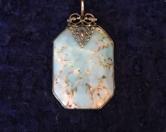 Vintage 1960s blue and white marbled pendant with antique filagree bezel
