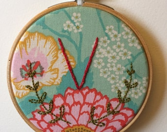 Embroidered initial V