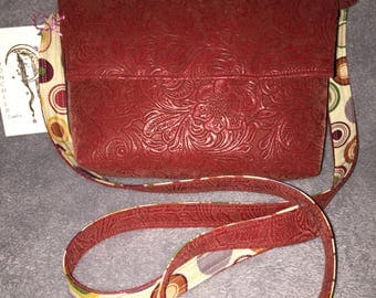 Red Vegan Embossed Leather Cross Body Purse (small), inside has multi colored circles printed on a beige background