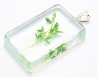 Rectangular resin pendant with green grass