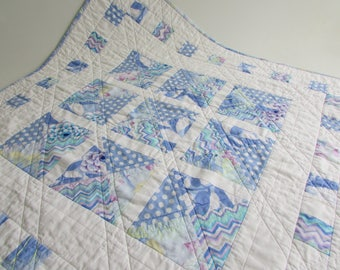 Quilted Square Table Topper in pastel blue Kaffe Fassett prints adds colorful beauty to your home!