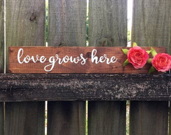 Love Grows Here handpainted sign