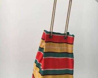 Vintage bag with wooden building blocks