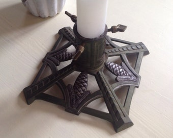 Christmas tree stand with beautiful cones decorated with heavy metal