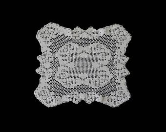 Vintage handmade crocheted doily -- white handmade doily with elegant scrolls -- 10x9 inches / 25x23 cm