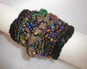 bracelet, armmanchette,beadwork on leather, embroidering,