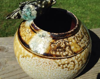 "6"" Wood fired salt glaze vase w  bird with and inpressed design detail"