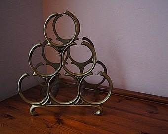 Vintage brass 6 bottle wine rack.