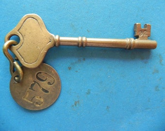 "Antique Brass Skeleton key W/ Brass tag. 4 1/8"" Long. Old & Original."