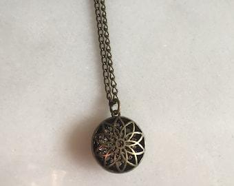 Antique bronze Filigree pendant.