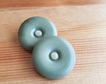 Vintage bakelite large sage buttons. Lot of 2. (Feb6)