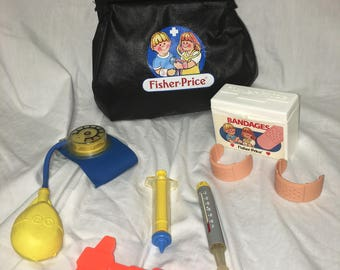 Vintage 1987 Fisher Price Medical Kit Black Bag with  Accessories model # 2010