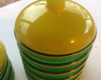 Set of 2 Green and Yellow Ribbed Glass Containers with Glass Lids