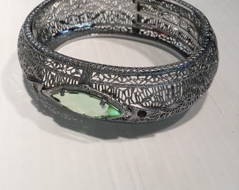 Vintage Art Deco Wide Filigree Bangle Bracelet With Peridot Colored Glass, Rhodium Plate