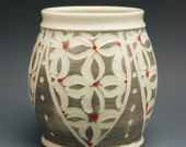Small grey handmade porcelain vase with etched white flowers
