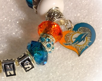 Miami  Dolphins inspired Jewelry bracelets body Bling. These are VERY different and have a FANTASTIC fit. The Ultimate inspired Dolphins
