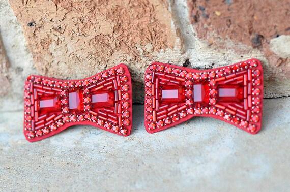 Replica hand-sewn ruby slipper bows in The Wizard of Oz