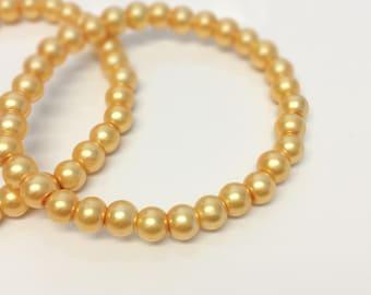Metallic Gold Glass Pearl Wedding Bridesmaid Accessory Gift. Stretchy Elastic Bracelet Pair.