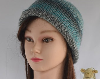 Lady's knitted hat - cloche style with roll-up brim -  variegated turquoise, petrol blue and grey