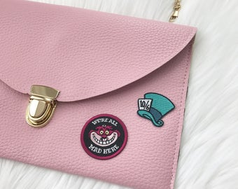 leather envelope clutch with patch / mad hatter / cheshire cat