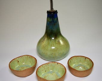 Olive oil dispenser set with three small pinch pots for dipping sauce in beautiful blue and light green glazes