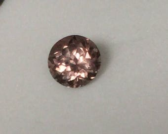 Rare color change garnet, 5.5mm round
