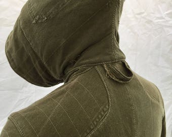 A unique, hooded jacket made from repurposed military canvas