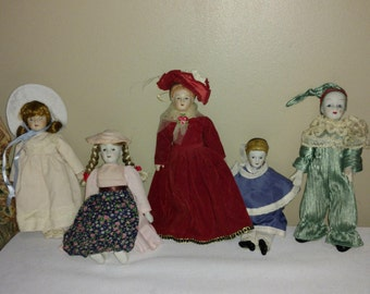 "Family of Five Vintage Porcelain Dolls 7-9"" Tall"